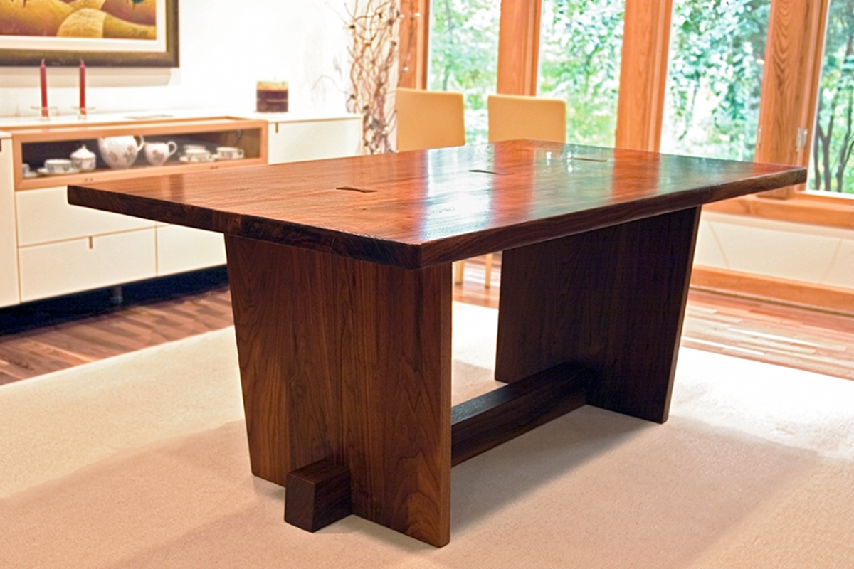 Custom trestle dining table, shown in walnut
