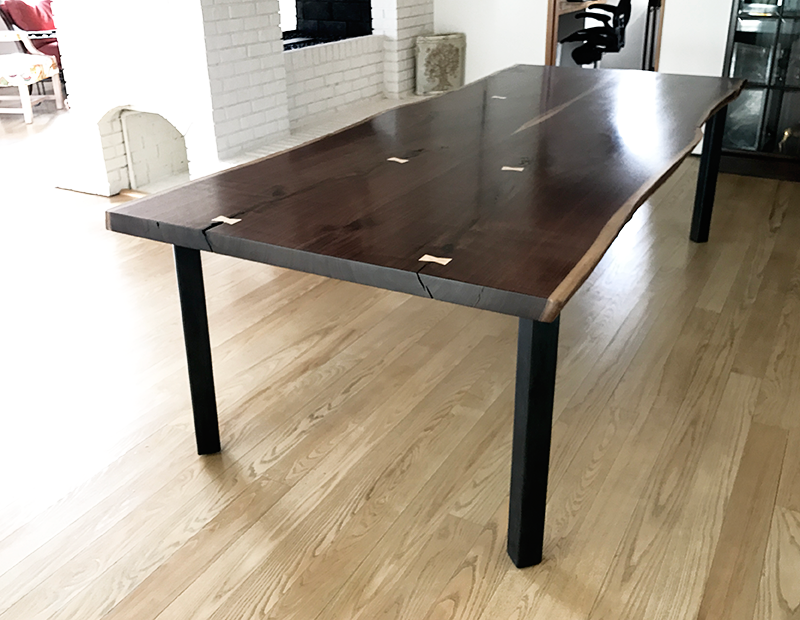 Custom slab top table, bookmatched walnut, steel base